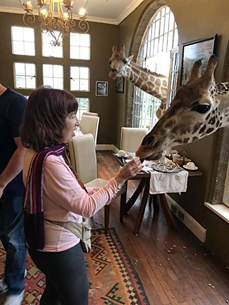 Rozanne Feeding Giraffe